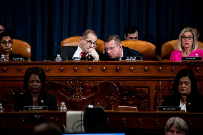 WASHINGTON, DC – DECEMBER 09: (L-R) House Judiciary Committee Chairman Jerrold Nadler (D-NY) and ranking member Doug Collins (R-GA) speak to each other during testimony before the House Judiciary Committee in the Longworth House Office Building on Capitol Hill December 9, 2019 in Washington, DC. The hearing is being held for the Judiciary Committee to formally receive evidence in the impeachment inquiry of President Donald Trump, whom Democrats say held back military aid for Ukraine while demanding they investigate his political rivals. The White House declared it would not participate in the hearing. (Photo by Anna Moneymaker - Pool/Getty Images)