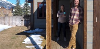 Jason and Sara Hogan keep distance from each other outside their home in Crested Butte South, Colorado. Sara, a physical therapist, is pregnant with the couple's first child.
