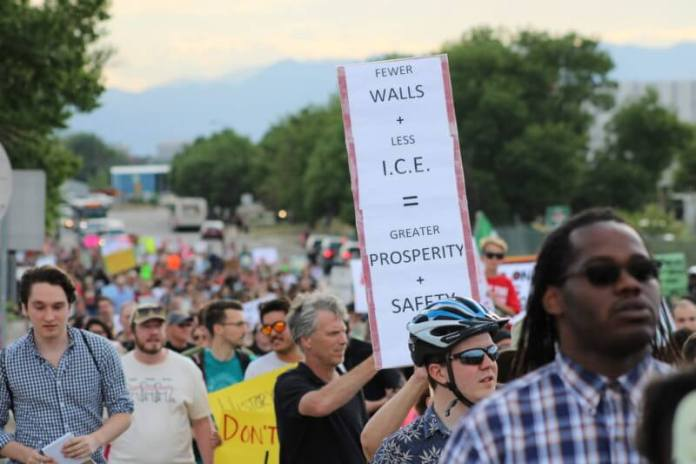 More than 1,000 people marched on July 12, 2019 in protest of the detention of immigrants in private prisons, including the detention facility in Aurora, Colo. run by GEO Group.