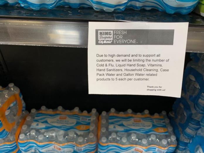 A Glendale King Soopers limits the sale of bottled water among other staples to customers stocking up in response to uncertainty over the spread of COVID-19. Grocery stores across the country are racing to keep supplying toilet paper, sanitizer and other items. (Photo by Alison Cooper, March, 11, 2020.)