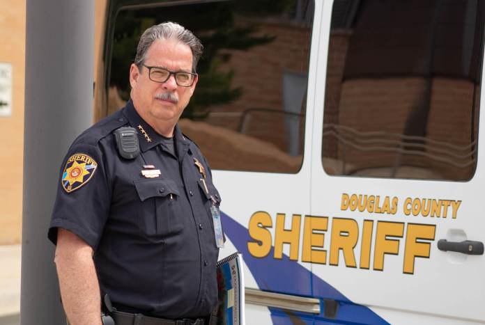 Tony Spurlock, sheriff of Douglas County, does his daily work at the Douglas County Sheriff's Department in Castle Rock, Colorado on June 27, 2019. Spurlock has been sheriff since 2015 and has a 39-year law enforcement career. Spurlock is an outspoken proponent of the red flag bill and has been a major part of its propulsion into being signed as well as fully laid out. (Austin Fleskes | Colorado Independent)