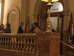 Business as usual: lobbyists gathered outside the Senate (they're not allowed on the floor of the Senate or House) to talk business and bills.