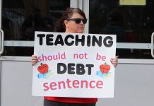 Mindy Thompson, teacher and union representative at Kaiser Elementary, demonstrates her support for Amendment 73 during a rally in Denver on Friday, Oct. 5, 2018. The measure, which would have raised taxes on corporations and high-income households for education funding, was resoundingly rejected by voters. (Photo by Rachel Lorenz)