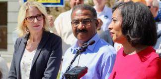 Mayoral hopeful Jamie Giellis, left, with former rivals Penfield Tate and Lisa Calderon at unity rally opposing Mayor Michael Hancock on May 14, 2019. (Colorado Independent photo by Alex Burness)