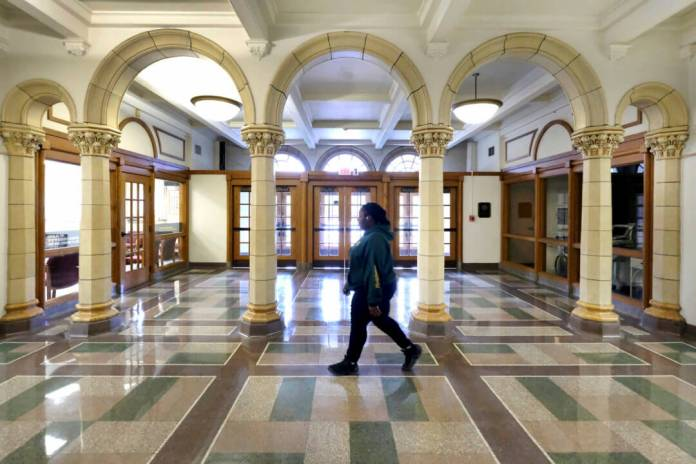 Student walks down a hallway at a public high school. A new study shows racially integrated high schools often conceal segregated classes.