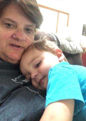 Special education teacher Julie Bryant snuggles with grandson Bentley while working from home in Tell City, Indiana on March 17, 2020.