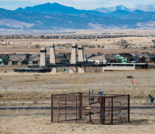 Under the new MOU with Broomfield, Extraction would abandon the Lowell Pad, pictured here, and put in a new 19-well site named Livingston just southwest of Lowell, between Wildgrass and Anthem developments. (Ted Wood/The Story Group)
