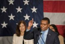 Newly elected Congressman Joe Neguse speaks at the Westin Downtown Denver on Nov. 6, 2018. (Photograph by Evan Semón for The Colorado Independent)