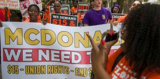 FORT LAUDERDALE, FLORIDA - MAY 23: People gather together to ask the McDonald's corporation to raise workers wages to a $15 minimum wage as well as demanding the right to a union on May 23, 2019 in Fort Lauderdale, Florida. The nation wide protest at McDonald's was held on the day of the company's shareholder meeting. (Photo by Joe Raedle/Getty Images)