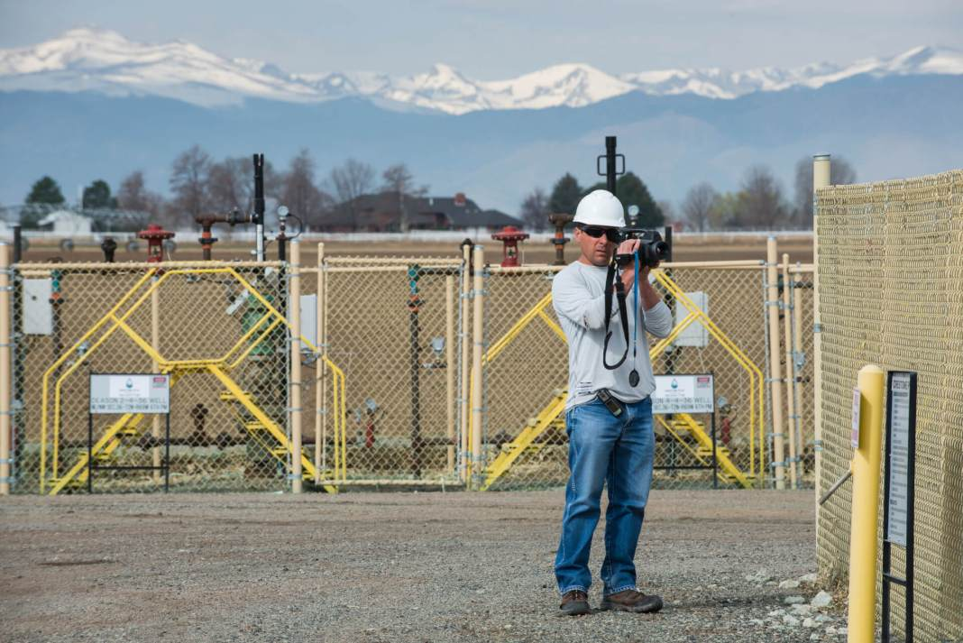 Patrick Murphy, Boulder County Public Health employee, uses a FLIR infrared camera to check for gas leaks at a operating well pad in eastern Boulder County. (Photo by Ted Wood/The Story Group.)