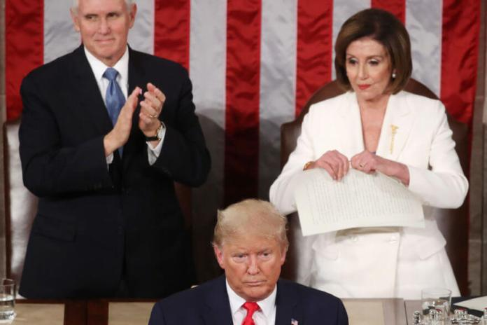 WASHINGTON, DC - FEBRUARY 04: House Speaker Rep. Nancy Pelosi (D-CA) rips up pages of the State of the Union speech after U.S. President Donald Trump finishes his State of the Union address in the chamber of the U.S. House of Representatives on February 04, 2020 in Washington, DC. President Trump delivers his third State of the Union to the nation the night before the U.S. Senate is set to vote in his impeachment trial. (Photo by Mark Wilson/Getty Images)