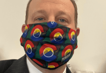 Gov. Jared Polis shows off his new face mask on April 3, 2020. He is encouraging Coloradans to wear masks when out going grocery shopping or on other essential business. (Screenshot from @jaredpolis)