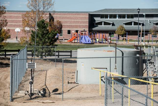 Silver Creek Elementary, in Thornton. Oil and gas operations are 350 feet away from the playground. (Photo by Ted Wood/The Story Group.)