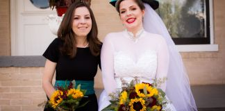 """Sara Wittner (left) and her sister Grace Sekera on Sekera's wedding day. Wittner began using narcotics again after the COVID-19 pandemic dismantled elements of her sobriety support system. On the Thursday after Easter, Sekera discovered her sister's body. """"No little sister should have to go through that,"""" Sekera says."""