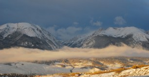 Usually, the sun shines above the clouds, with the valleys early morning shadow. Dark clouds to the west, behind the Gore Range, are deliving more snow as this post is being edited.