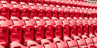 Bleachers at the Magness Arena the University of Denver. Students filed a petition to DU to reduce their tuition as school services were reduced due to the coronavirus pandemic. (Photo by arinahabich from Getty Images via Canva)