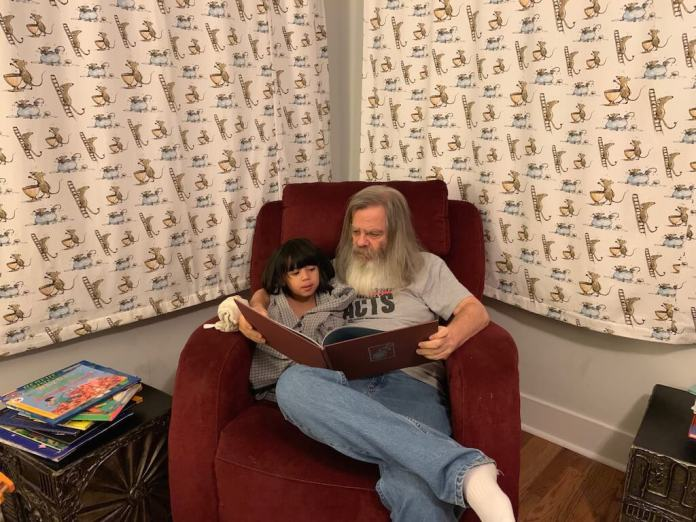 It's night 2 of Hanukkah and the night before Christmas Eve as Grandpa Littwin reads The Polar Express to Lalo in his favorite reading chair. Note that both Grandpa and Lalo are wearing Grandpa shirts. (Photo by Angie Littwin)