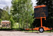 At the Country Road 133 and County Road 3 junction, a sign expresses that nonessential travel in Gunnison County is illegal on Wednesday, May 20, 2020.