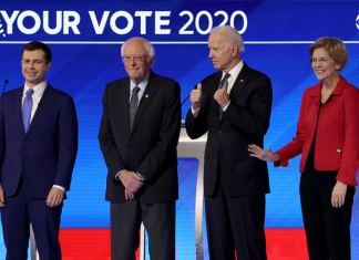 (L-R) Democratic presidential candidates former South Bend, Indiana Mayor Pete Buttigieg, Sen. Bernie Sanders (I-VT), Sen. Elizabeth Warren (D-MA), and former Vice President Joe Biden, arrive on stage for the start of a Democratic presidential primary debate in the Sullivan Arena at St. Anselm College on February 07, 2020 in Manchester, New Hampshire. Seven candidates qualified for the second Democratic presidential primary debate of 2020 which comes just days before the New Hampshire primary on February 11. (Photo by Win McNamee/Getty Images)
