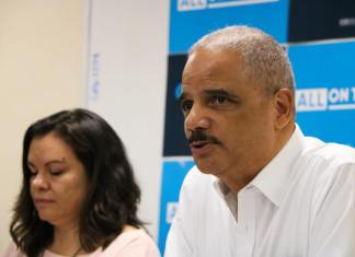 Former U.S. Attorney General Eric Holder (r) and Olivia Mendoza (l) speak Saturday, Oct. 26 roundtable discussion on redistricting, voting rights and the 2020 U.S. Census. (Photo by Alec Williams)