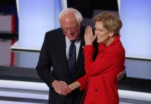 Elizabeth Warren and Bernie Sanders in a more congenial moment. A 'feud' between the two has since erupted.