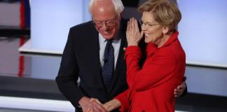 DETROIT, MICHIGAN - JULY 30: Democratic presidential candidate Sen. Bernie Sanders (I-VT) (R) and Sen. Elizabeth Warren (D-MA) greet each other at the start of the Democratic Presidential Debate at the Fox Theatre July 30, 2019 in Detroit, Michigan. Both candidates say they support Medicare4All, which is expected to be debated during round 3 of the Democratic primary debates on Sept. 12, 2019. (Photo by Justin Sullivan/Getty Images)