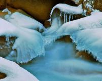 An icy wonderland hidden deep in the shadows of the Snake River Canyon near Keystone, Colorado.
