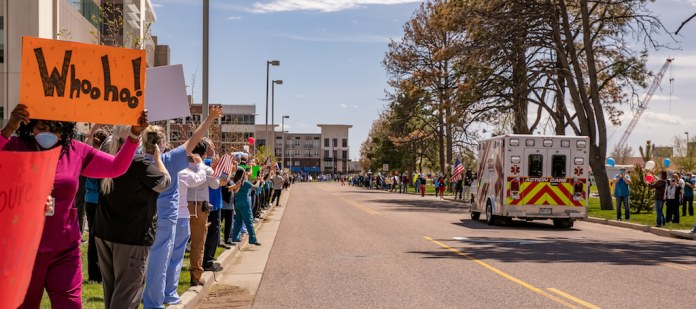VA medical center workers lined Wheeling Street in Aurora this afternoon to salute and celebrate Big T's survival and recovery. (Photo by Marie Dominique Verdier)