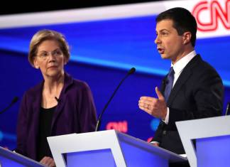WESTERVILLE, OHIO - OCTOBER 15: Sen. Elizabeth Warren (D-MA) looks on as South Bend, Indiana Mayor Pete Buttigieg speaks during the Democratic Presidential Debate at Otterbein University on October 15, 2019 in Westerville, Ohio. A record 12 presidential hopefuls are participating in the debate hosted by CNN and The New York Times. (Photo by Win McNamee/Getty Images)
