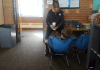 Principal Stacy Bedell listens to a student at Eiber Elementary in Jeffco Public Schools. Colorado's suburban school districts are grappling with more schools needing extra resources to address the economic and other challenges students face. (Photo by Yesenia Robles, Chalkbeat)