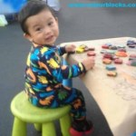 cutebabyplayingwithcolourblocks-300x268