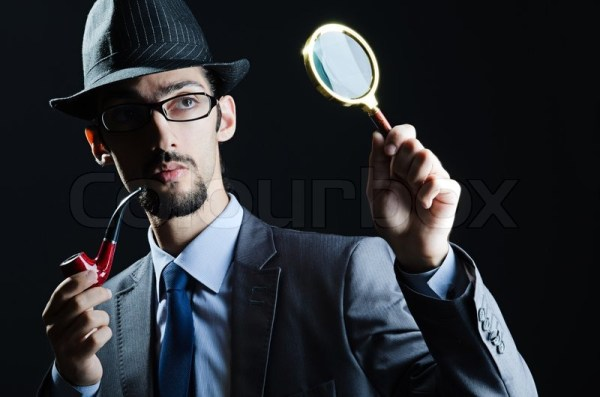 Detective with magnifying glass and pipe | Stock Photo ...