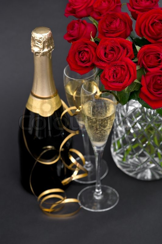 Red Roses And Champagne Festive Decoration Stock Photo
