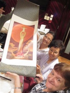 A silk scroll of Our Lady of China was presented to Sr Fintan by her HPC colleagues. Lower rt of photo, Columban Sister Pat Zandrews, Boston, USA, who has conducted several Clinical Pastoral Training Courses for the Hong Kong RC Diocesan HPC.