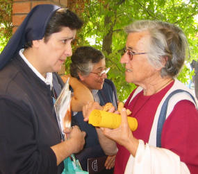 Sister Carmen shares pastoral concerns with Dominican Sister Gloria during a seminar.