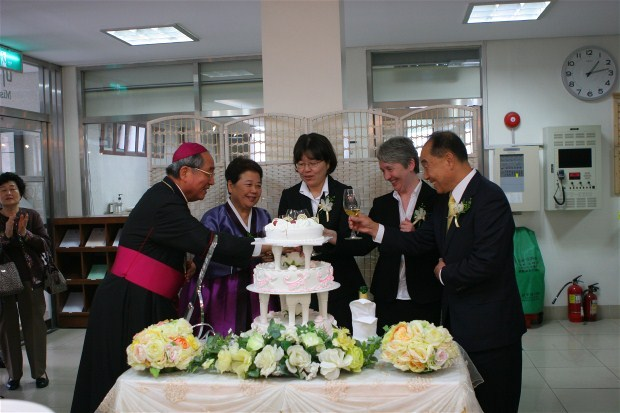 After the ceremony, a very joyful moment as Sister Erisa is joined by her parents, Bishop Lee and Sister Ann Gray for the cutting of the cake and the toast!