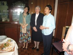 Sisters Angela Yoon, Joan and Lucia So Yim Mei singing the grace before the celebration meal