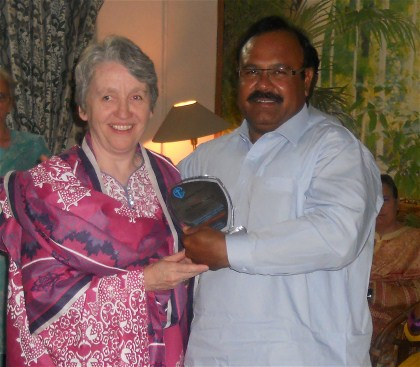 ...and the Housing Project Contractor, Mr Yunus Sohail, is very pleased to recieve the Plaque of Appreciation from Sister Ann Gray