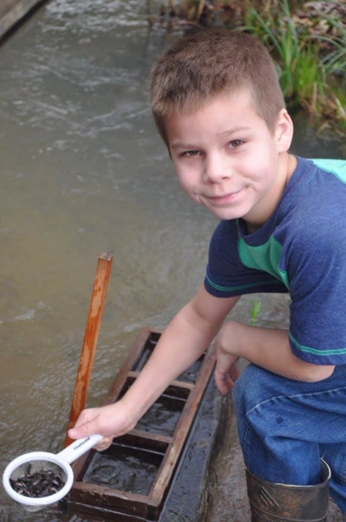 Student at annual salmon release