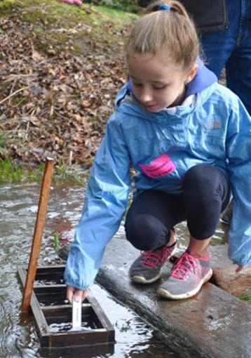 Student at annual fish release