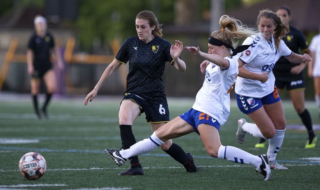 Kelly DeNiro keeps possession in the Eagles 1-1 draw with Dayton on June 22, 2019. | Daniel Herlensky