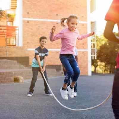 kids playing jumping rope child