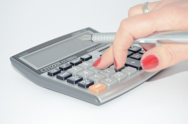 woman touching calculator
