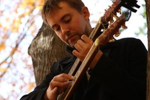 book or hire two handled guitar player Mark Kroos