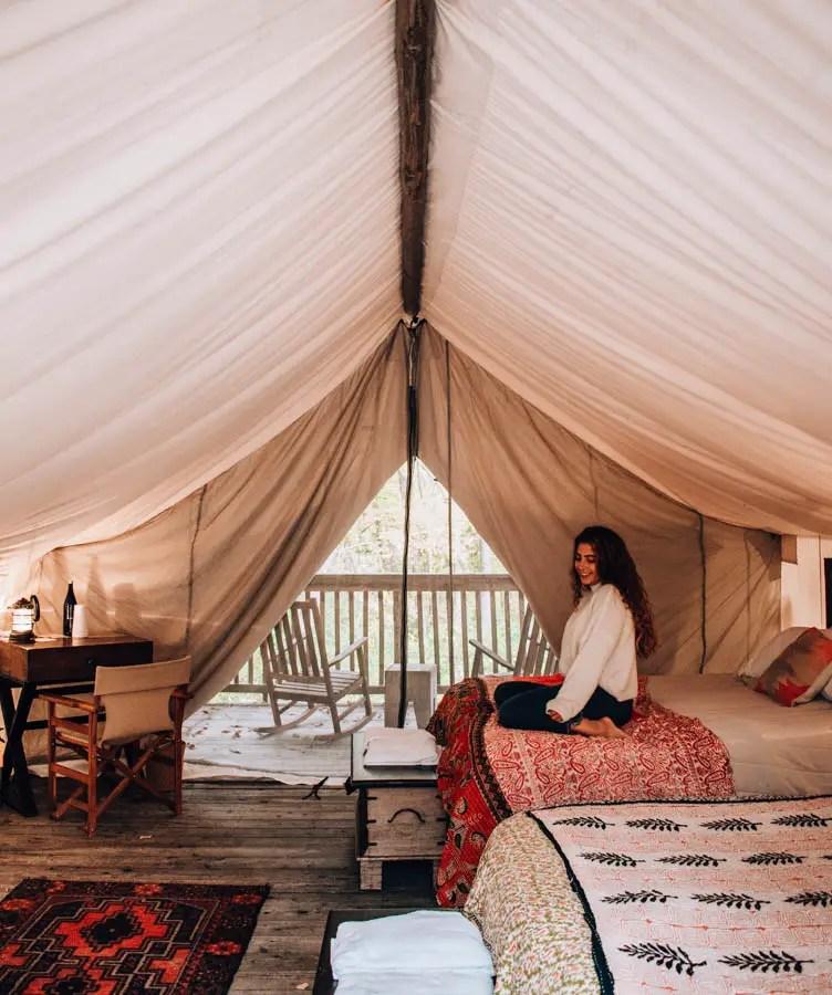Anna Hammerschmidt in tent at Firelight Camps in Ithaca