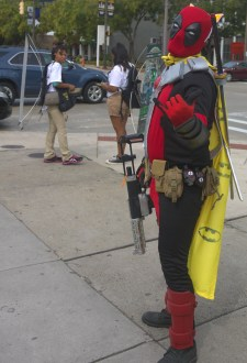 Deadpool cosplaying as Batman