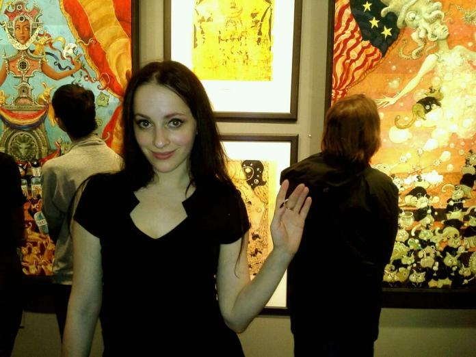Photo of Molly Crabapple at  The Shell Game exhibit by Dre Grigoropol