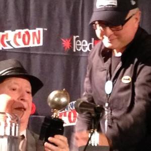 Michael Uslan presents the Eisner Award to Irwin Hasen.