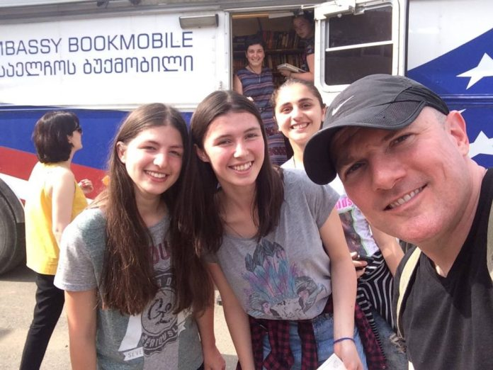 With the US Embassy Bookmobile at the Tserovani IDP settlement camp.