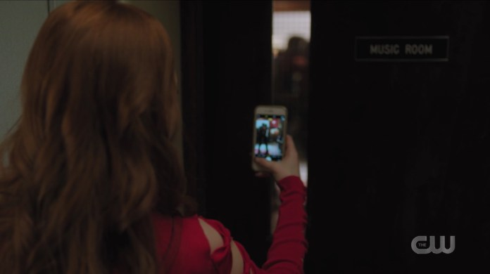 Cheryl snaps of photo of Betty and Archie kissing in Riverdale High